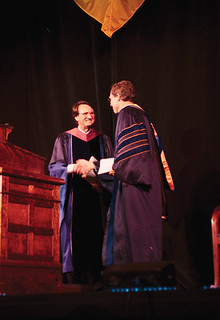 Board Chair Stewart Smith congratulates newly inaugurated President David Oxtoby in 2003.