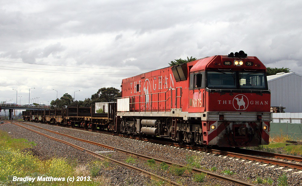 NR75 (Ghan) with rail wagons from Somerton to MOT at Albion (28/3/2013) by Bradley Matthews