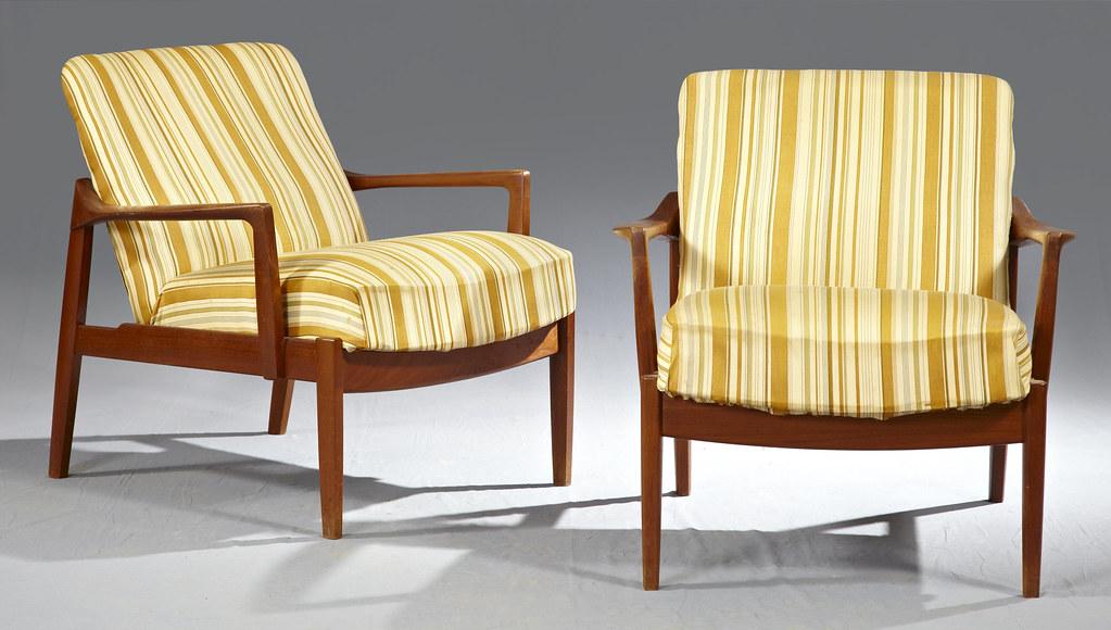 Pair of Finn Juhl Danish Modern Carved Teak Arm Chairs
