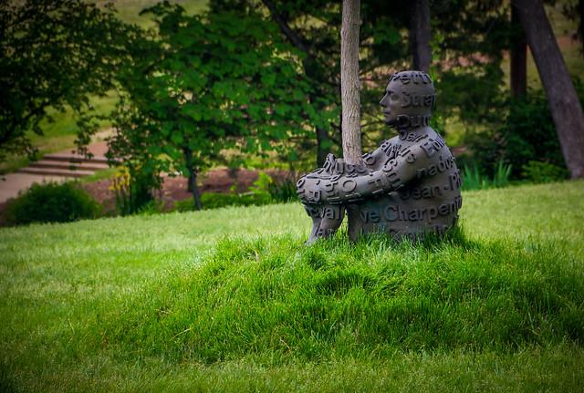 Artsy men just sitting in the yard.  #3