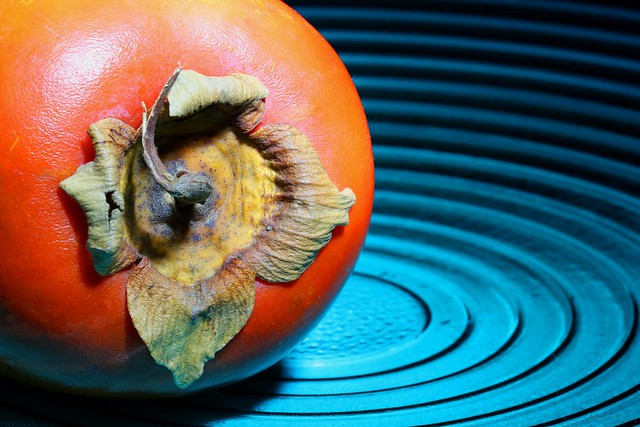 kaki fruit on dish