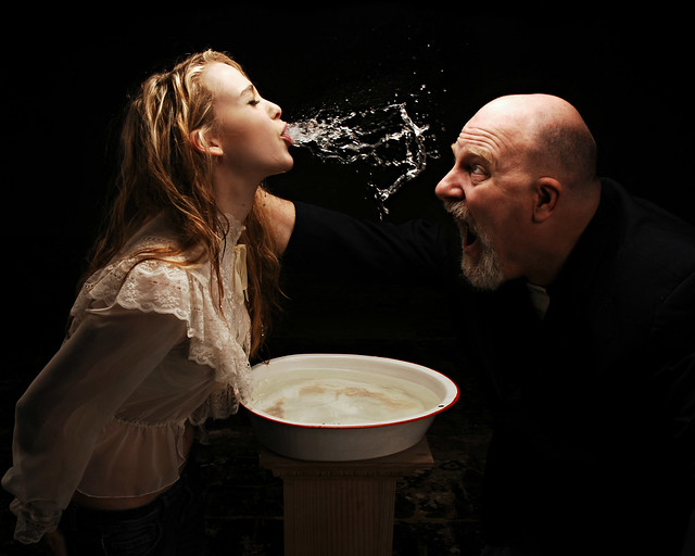 The preacher dunked her head 3 times in the basin & called out for the demons to leave & then she spit water in his face. So he extemporaneously added a fourth & by the time she came up for air the demons were considerably more restrained.