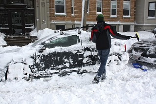 boston snow storm february 9 blizzard nemo man cleaning snow off of car