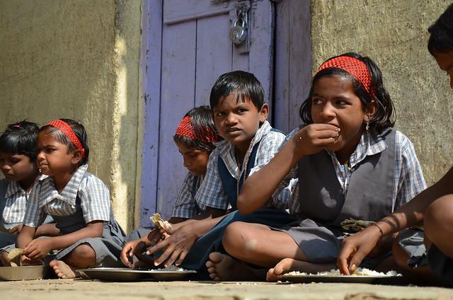 school children eat millet chappatis with rice and veg curry...