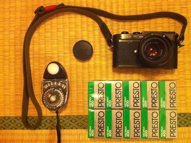 A camera, a light-meter & 10 rolls of film ...