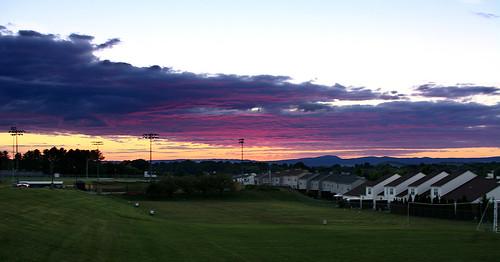 sky sunset purple blue red orange clouds outdoors outside houses highschool field