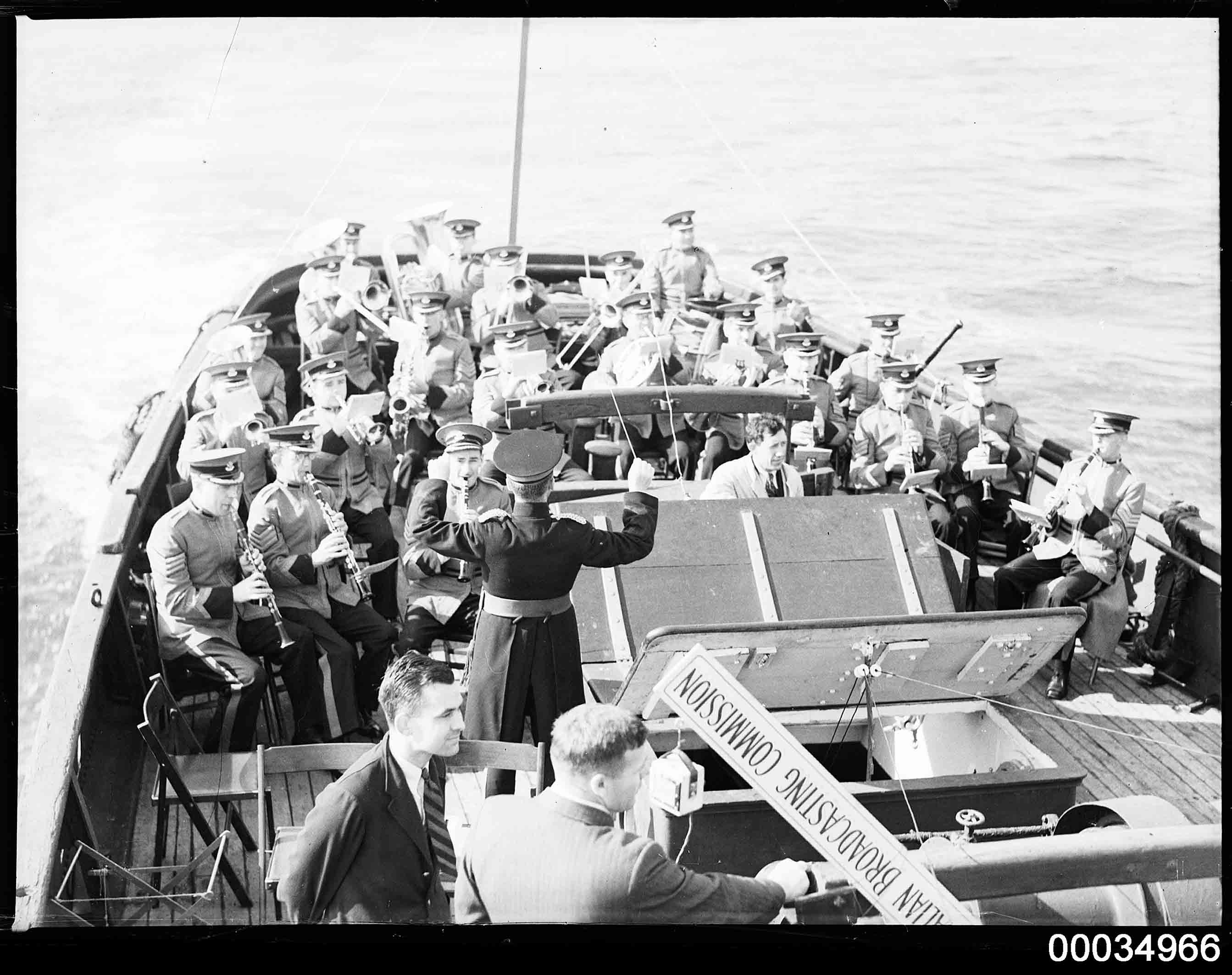 ABC Military Band playing with ABC commentator on a vessel, 1933-1951
