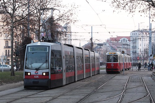 ULF-B tram 635 passes a older E class tram and C class trailer combo at Westbahnhof