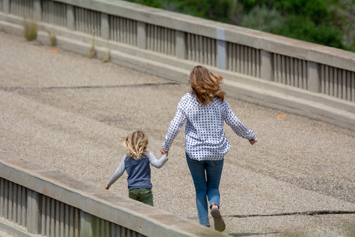 A mother and her child playfully run along the abandoned Arroyo Hondo bridge | by beltz6