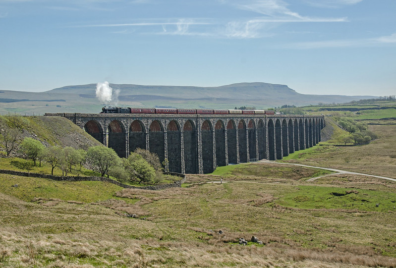 Ribblehead Viaduct on a warm May 15th afternoon. The train is the northbound Dalesman excursion from York to Carlisle, headed by 8F 2-8-0 48151.