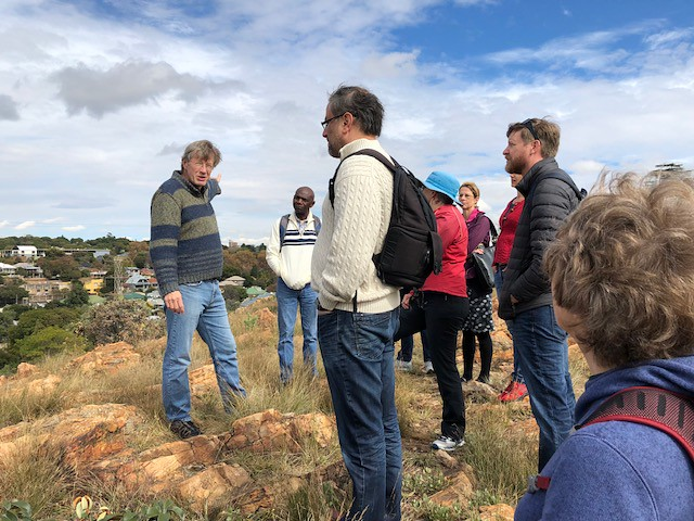 Day 1: Scholar Patrick Bond of University of Witwatersrand discusses Johannesburg's development with participants during the hike.