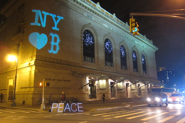 The Illuminator projecting messages of peace on the Brooklyn Academy of Music