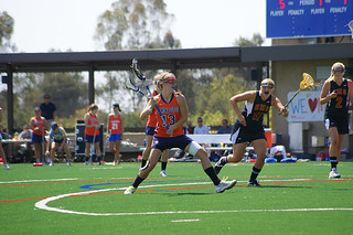 The women's lacrosse team plays a match on the roof of the new South Parking Structure