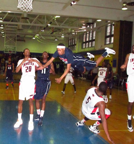 In this 2013 game vs. Imhotep, PET's Khaalis Carter goes flying through the air after being fouled on a drive. | by tedtee308