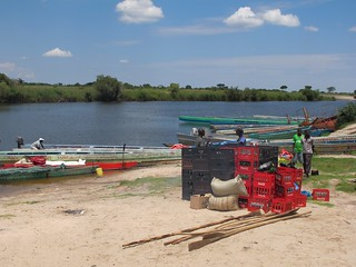 Coca-Cola gets everywhere. Crates waiting to be loaded onto canoes. | by ColaLife