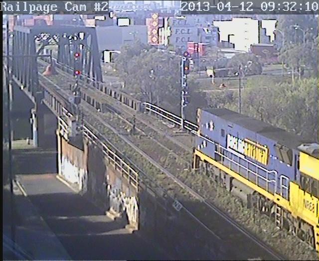 NR68 with empty rail train to MOT Steel terminal, ex ANZAC Siding, Spotswood 12-4-2013 by Railpage Bunbury Street
