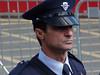 Tento policista se sice tvářil přísně a neústupně, ale nakonec ho – před celým Limassolem – roztančil polonahý transexuál. , foto: Petr Nejedlý