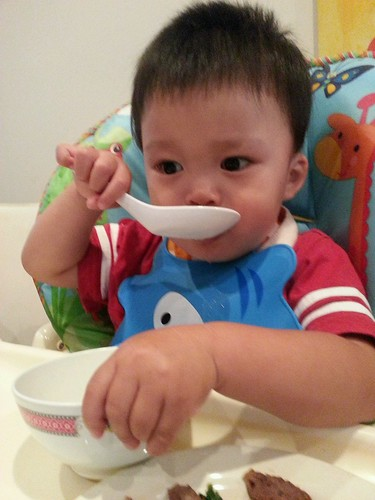 Tired Isaac drinking dried bokchoy soup with a Chinese soup spoon | by avlxyz