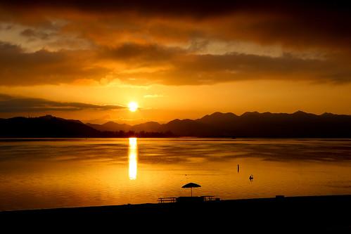 silhouette clouds sunrise lakeelsinore paulknight quixoteimagescom