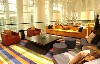 Lounge, contemporary design, yellow sofa, chairs, lamps, striped carpet, decor, interior, Renaissance Hotel, Schaumburg, Illinois, USA | by Wonderlane