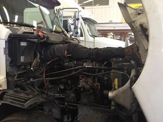 MechanincOnTruckEngine | by MDS Diesel Service Inc.