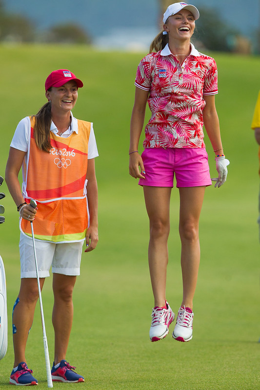 Klara Spilkova of the Czech Republic and her caddie Eva Kozeluhova react to being told the gallery on the second hole