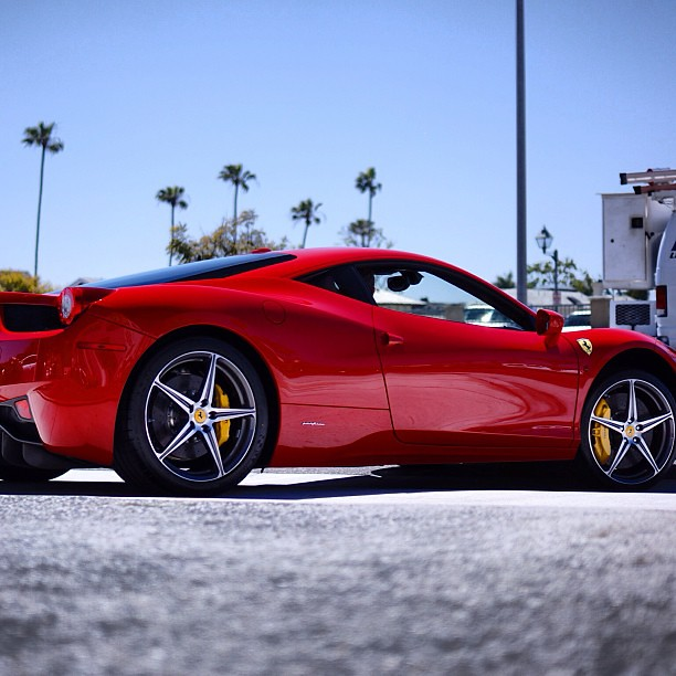 Beautiful glowing passionate fire red Ferrari 458 Italia w
