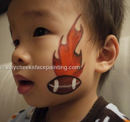 Football With Flame Cheek Art Silly Cheeks Face Painting Flickr