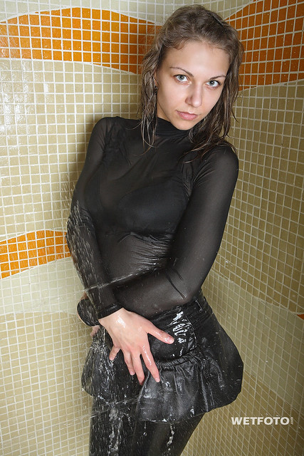 #258 Wetlook with Two Sexy Girls in Wet Tights and Leggings. Two beautiful brunette in leather jacket, tights and leggings in shoes on high heels get wet fully clothed in swimming pool and shower.