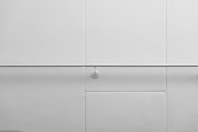 White handrail on a white wall