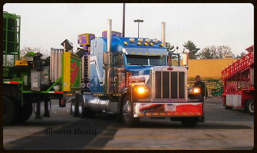 morning carnival blue red orange usa white green colors truck sunrise stars lights neon bright sweet steel awesome parking lot route chrome american rides trucks 28 custom bigtruck stainless peterbilt 18wheeler tractortrailer welldressed custompaint 379 derrynh oceanstatejoblot bluemetallic carnivaltrailer
