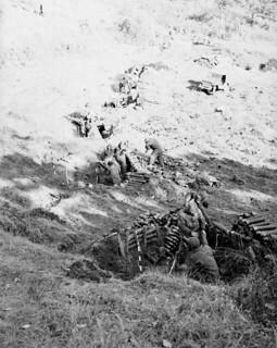 The mortars of the Royal 22nd Regiment blast away at the enemy / Les obus de mortiers du Royal 22e Régiment sont tirés contre l'ennemi