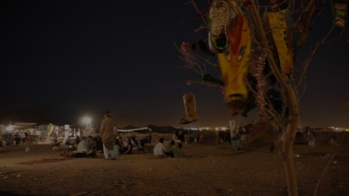 The shoe tree with the site in the background | by bedouin festival