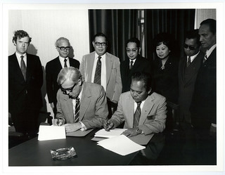 Philippines - April 1976 photograph of Mr Talboys signing a trade agreement in Wellington with the Philippines delegation
