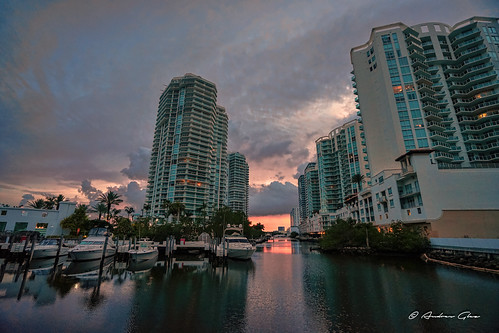 sunnyislesbeach architecture afternoon yacht colors building channel pier waterways water saltwater sky clouds walkingaround walking urbanexploration miamifl