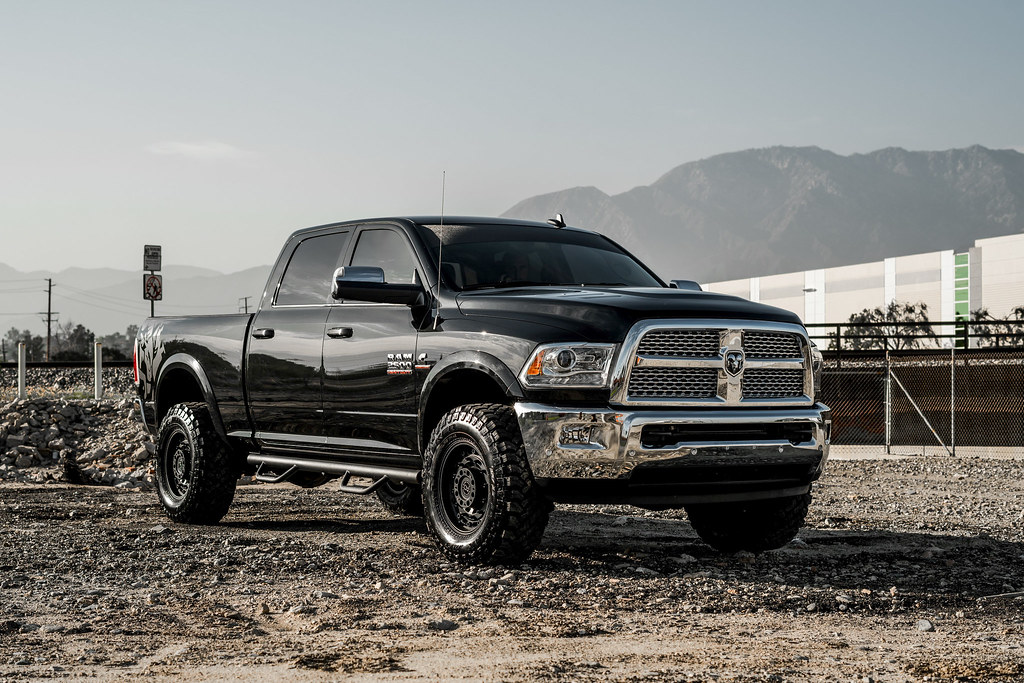 ram 2500 on black rhino arsenals wheels  platinum vinyl w