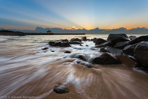 ocean sunrise landscape waves florida slowshutter sunrays satesh boyntonbeachinlet rocksonbeach peaceinart