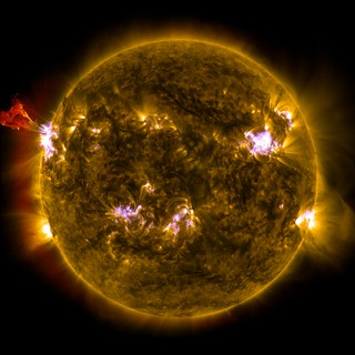 Sun Emits a Mid-Level Flare | by NASA Goddard Photo and Video