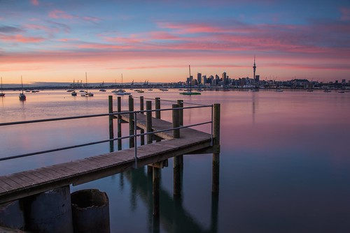 sunrise sky cloud pastels pink glow smooth calm pier jetty wharf city