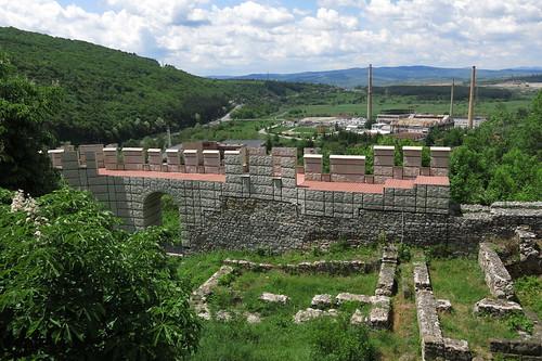 bulgaria българия pernik перник fortress medieval wall remains stone gate factory contrast
