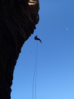 Michelle abseiling off Old Man of Hoy