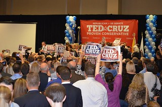Robin and Jim on podium on the the right at Ted Cruz Victory rally | by kwtp2012
