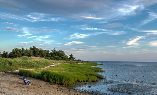 clinton clintontownbeach connecticut hdr longislandsound nikon nikond5300 outdoor beach chair clouds geotagged ocean sky tree trees water unitedstates newengland green marsh