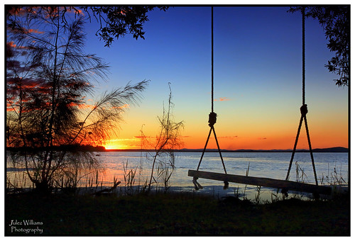 photoborder outdoor waterfront serene sunset dusk water sky swing newsouthwales australia smoke tree bay