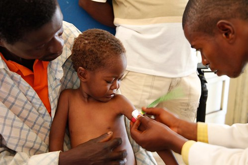 Medical staff examine a child for signs of malnourishment in DRC | by DFID - UK Department for International Development
