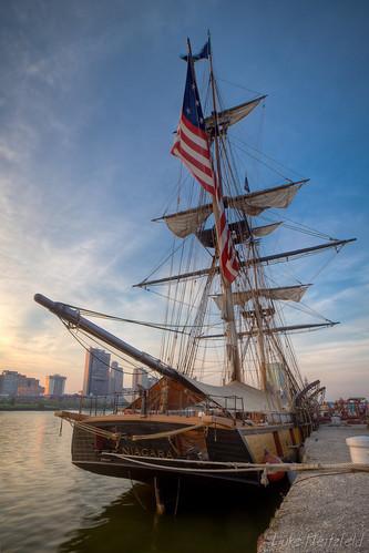 sunset water river evening boat ship lakeerie dusk flag unitedstatesofamerica rope niagara bow stern usnavy rigging clipper maumeeriver toledoohio