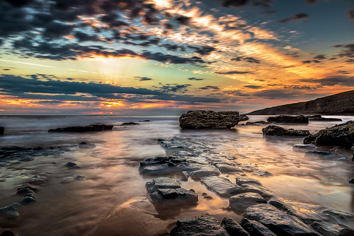 sunset ocean seascape rocks glow golden sea sand sky clouds wales uk southerndown