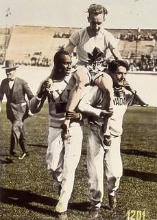 Percy Williams of Canada on the shoulders of his teammates after winning a gold medal at the IX Summer Olympic Games / Percy Williams (4e à gauche), du Canada, remportant la médaille d'or à l'épreuve du 200 m, aux IXe Jeux Olympiques d'été