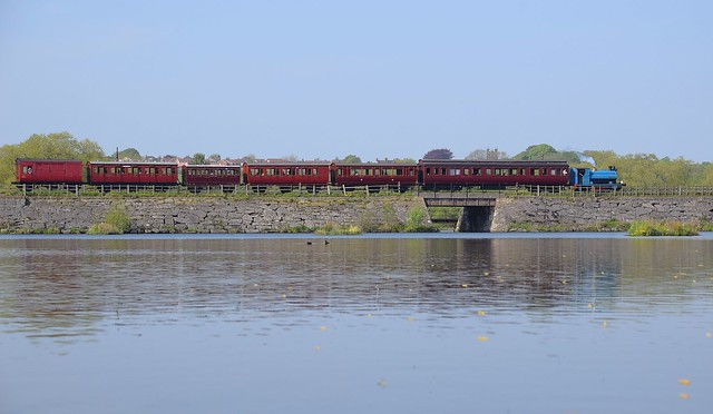 1949 Peckett No.2111 trundles across the reservoir, with an amazing rake of Victorian Carriages, at the Midland Railway Centre, Butterly. 07 05 2018