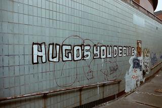 Hugos you decide - graffiti under Mancunian Way in Manchester